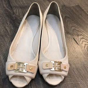 A used Tory Burch open toe wedge.